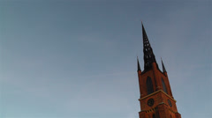 Stockholm Riddarholms Church 1 sunset tilt Stock Footage