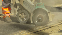 Roadworks Construction Asphalt or concrete cutting with saw blade Stock Footage