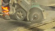 Stock Video Footage of Roadworks Construction Asphalt or concrete cutting with saw blade