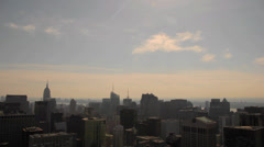 Timelapse clouds at sunset over midtown manhattan, new york - stock footage