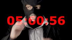 Masked criminal taking off mask countdown Stock Footage