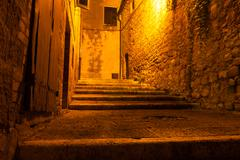 mysterious narrow alley with lanterns, italy - stock photo