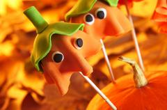 Stock Photo of cake pops with the shape of ghost halloween pumpkins