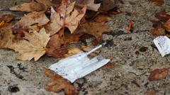 Drug addict's discarded needle (8) Stock Footage