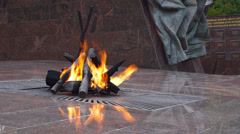"""Eternal flame"" at the memorial ""Partisan glade"" closeup Stock Footage"