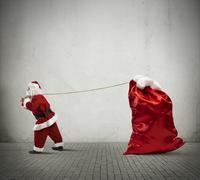 Santa claus with big sack Stock Photos
