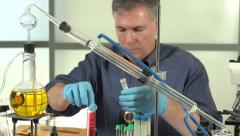 Police officer analyzing evidence in lab Stock Footage