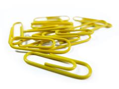 Yellow Paper Clips Isolated on White Background Close Up Stock Photos