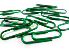 Green Paper Clips Isolated on White Background Close Up - stock photo