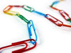 Colorful Paperclips Connected to Each Other - stock photo