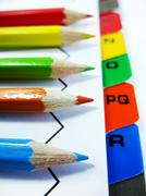 Colourful Pencils and Letters Stock Photos