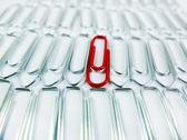 Stock Photo of Lots of Silver Paper Clips and One Red Paper Clip