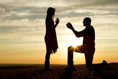 Sunset Marriage Proposal Stock Photos