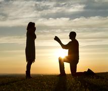 Sunset Marriage Proposal Stock Photos