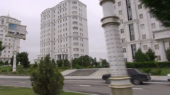 Driving past white marble buildings in Ashgabat, Turkmenistan Stock Footage