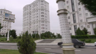 Stock Video Footage of Driving past white marble buildings in Ashgabat, Turkmenistan
