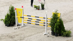 Rider on horse jumps over barrier at international competitions Stock Footage