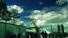 Tourists and Louvre art museum at the Tuileries gardens Stock Footage