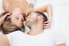 Stock Photo of romantic couple in bed