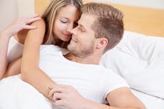 happy couple in bed - stock photo