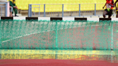 Sportsmen overcome water obstacle during race. - stock footage