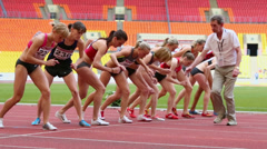 Sportswomen start race at Grand Sports Arena of Luzhniki Stock Footage