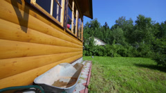 Little girl walk at terrace of wooden house at summer day Stock Footage