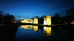 Tourists walk near pond and Temple of Debod with illumination Stock Footage