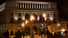 Tourists walk near Teatro Real at evening Stock Footage