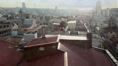 Cityscape with roofs of many houses and buildings at morning Stock Footage