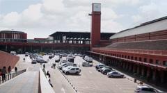 People walk at parking near Atocha railway station Stock Footage