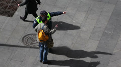 Policeman shows direction for tourist at sunny day Stock Footage