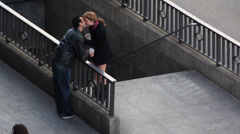 Young couple kiss near subway entrance at spring day Stock Footage