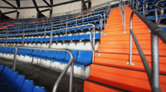 Panorama of blue grandstand with stairs at football stadium Stock Footage