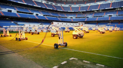 Light system for growing grass at empty football stadium Stock Footage