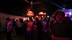 Crowd of fans dance near stage during concert in cafe-club Gogol Stock Footage