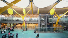 Passengers moves in hall with elevators at Barajas Airport Stock Footage