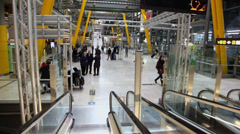 Passengers moves in hall with escalators at Barajas Airport Stock Footage
