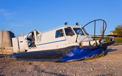 hovercraft arriving on shore - stock photo