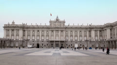 People walk by square near Palace of Spanish kings in Madrid Stock Footage
