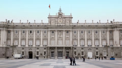 Tourists walk near Palace of Spanish kings in Madrid, Spain. Stock Footage