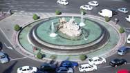 Stock Video Footage of Traffic on Cebeles Square around fountain
