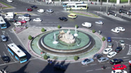 Stock Video Footage of City traffic around fountain at Cebeles Square