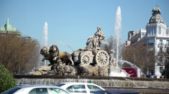 Traffic near fountain at Cebeles Square at sunny day Stock Footage