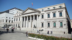 People walk near Spanish Congress of Deputies building Stock Footage