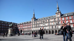 People walk by Plaza Mayor with Monument to Philip III Habsburg Stock Footage
