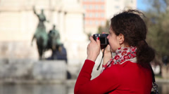 Woman photographs monument to Cervantes at Espana Plaza Stock Footage