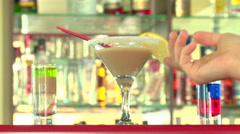 barman prepares alcoholic cocktails - stock footage