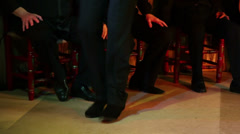 Legs of man which dances in flamenco style at small stage Stock Footage
