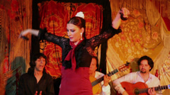 Woman dances in flamenco style with castanets Stock Footage